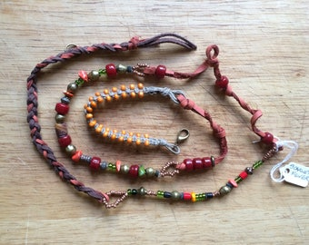 Multi wrap around Boho bracelet, handmade with trade beads, leather and macrame. For festivals and summer wear.