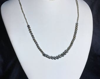 Metallic necklace with matching earrings,