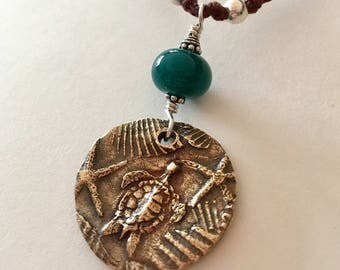 Sea Turtle And Sand Dollars Reversible Necklace With Glass Hand Sculpted In Bronze
