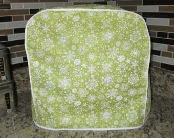 Kitchen aid mixer cover in a light chartreuse green with white snowflakes