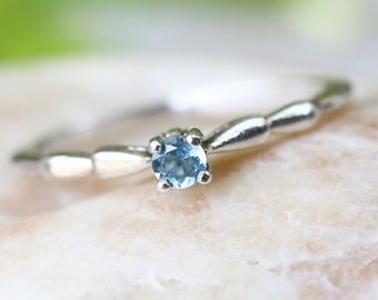 Aquamarine ring in sterling silver band
