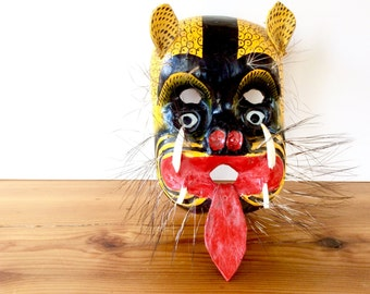 Mexican Jaguar Mask. Weird Vintage Painted Carved Wood Mask. Boar's Teeth, Hair, Leather Tongue, Ears, Glass Eyes. Yellow / Black / Red.