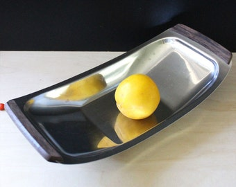 Vintage Danish modern stainless steel dish with wooden handles.