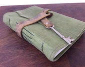 Earthy green leather journal with reclaimed leather and recycled paper by Binding Bee