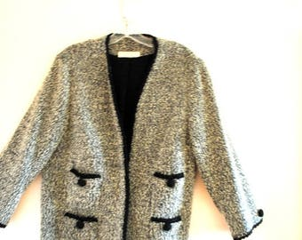 Jackie O vintage 60s gray boucle jacket with a black cord trim, buttons and 4 pockets. Made by Jon Michaels. Size M.