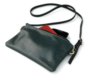 Alaska leather handbag - clutch - wristlet made from repurposed turquoise Alaska Airlines seat leather.