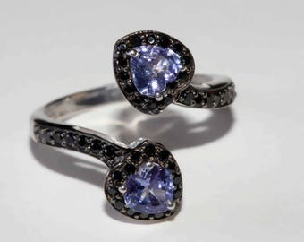 Genuine tanzanite heart shaped stone and black spinel accented bypass ring size 10 shipping included U.S.A and Canada