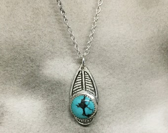 Breathe etched sterling silver and turquoise teardrop pendant with an graphic linear design, a perfect pop of color for spring
