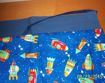 Utility Apron, designed for teachers. Four pockets (two on surface and two under the first two).