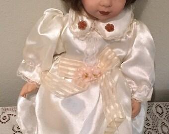 Musical porcelain doll
