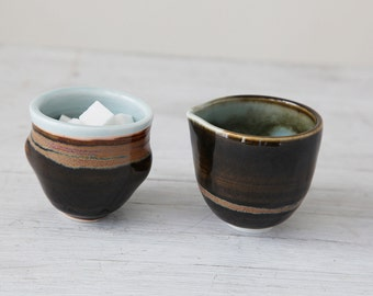 Wheel Thrown  creamer and sugar bowl set with robin's egg blue interior and brown stripes
