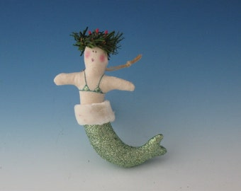 Small curved mermaid with holiday wreath on her head