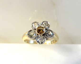Circa 1900.  Fancy Yellow Diamond Flower Ring