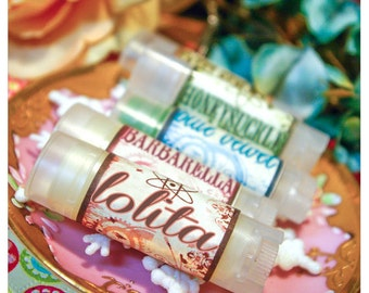lolita - sassy bubble gum flavored lip embellishment - housed in nifty frosted dispenser