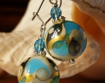 Precious earrings in Murano glass