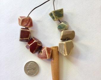 Geometric high fire beads in earthtone glazes.