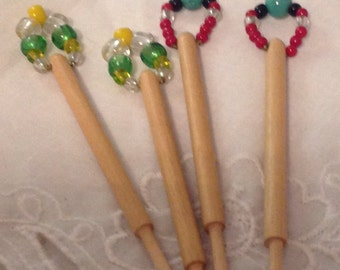 Wooden lace making bobbins with glass beads