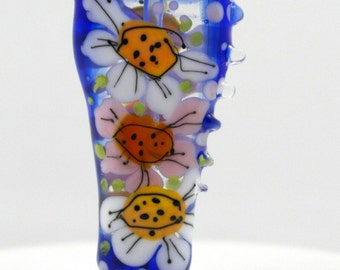 Glass focal bead , lampwork glass bead , flower bead , blue bead , ladybug bead , meadow , artisan focal bead , blue lampwor bead