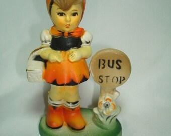 1960s Made in Hong Kong Hummel Girl at Bus Stop Ornament.