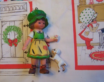 little girl with her lamb ornament
