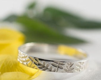 Silver Botanical Wedding Band: A sterling silver textured wedding ring