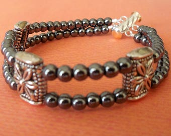 Double strand black and silver bracelet