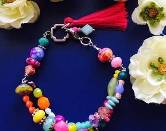 Gorgeous colorful glass beaded charm bracelet with golden links and clasp. Pretty neon bright summer inspired colors.