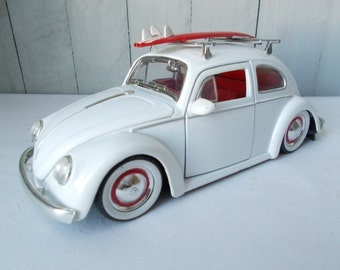 1959 Volkswagen Beetle with Surfboard