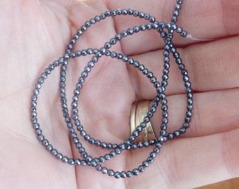 2 mm  hematite faceted  round beads FULL STRAND