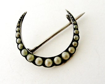 Antique sterling silver crescent moon brooch set with faux pearls