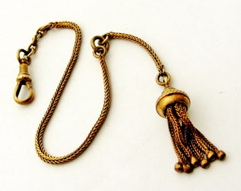 Antique albertine watch chain in old gold pinchbeck or brass with tassel