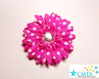 One pink and white polka dot hair flower with a rhinestone. Portion of sale goes to charity.