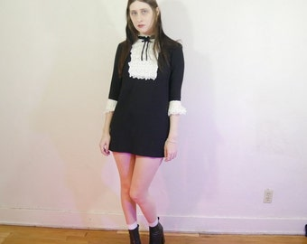 vtg 60s back and white lace chest and bow detail gothic mini dress size XS