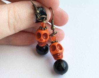 Orange and Black Skull Bead Antique Brass Earrings
