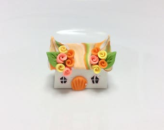 Miniature fairy cottage in pink, yellow and orange handmade from polymer clay