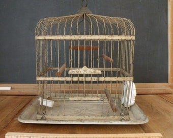 Vintage Lindeman birdcage , porcelian feeders , old worn creamy paint , perfect patina With wooden swing