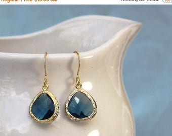 20% off. Navy Blue Crystal Earrings. Gold or Silver Bezel Setting. Framed and Faceted Crystal Earrings. More Options.