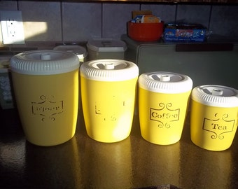 Vintage 4 piece bright yellow and white plastic canister set Flour, sugar, Coffee, Tea set