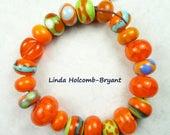 Lampwork Glass Bead Set of Mixed orange Beads- set of 21