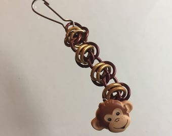 Chainmaille zipper pull with monkey face button