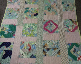 Vintage quilt:  Scrappy quilt from the 1940's hand pieced and quilted  cotton batting feed sack fabric back