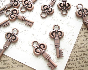 Skeleton Key Charms. 12 Antiqued Copper Vintage Style Small Key Stampings. Steampunk, Jewelry, Scrapbooking, Crafts, Destash Supplies Sale.