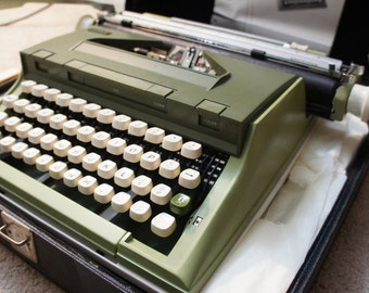 Sears Newport Portable Mechanical Typewriter with original case and papers. Made in Portugal.