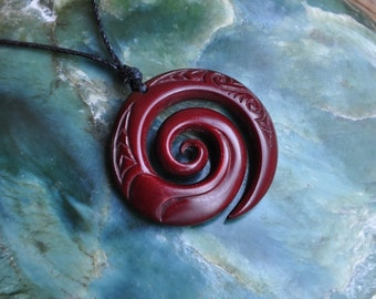 Maori Koru with wave design~ engraved & naturally stained