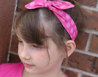 Made to match knotted fabric headband.  Custom made to match any dress purchase.