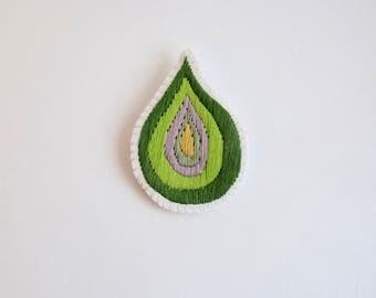 Hand embroidered brooch, abstract green design using cotton threads on cream muslin, cream felt backing summer fashion An Astrid Endeavor