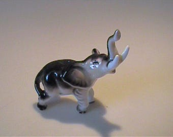 Vintage 1960's miniature bone china elephant with trunk up - Japan