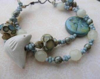 handmade lampwork and ceramic cream bird bracelet, copper jewellery UK