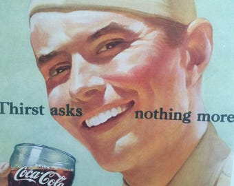 Original 1950s Coca-Cola advert. Iconic Coke advertising. This ad features a smiling solider.