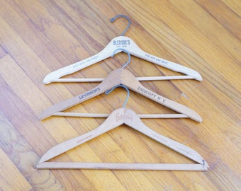 Nice Wood Advertising Hangers -- Set of Three Vintage Hangers with Stamped Impressions -- Cool & Collectable Hangers